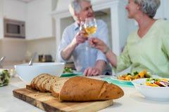 Senior couple toasting glasses of wine Stock Photos