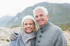 Senior couple together on a rocky landscape Royalty Free Stock Images
