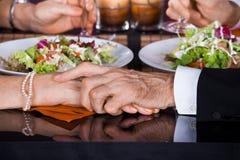 Senior couple touching hands Royalty Free Stock Photos