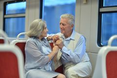 Senior couple in train Royalty Free Stock Photography