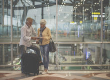 Senior couple traveling airport scene royalty free stock photography