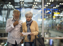 Senior couple traveling airport scene Concept Stock Images