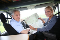 Senior couple travelling in camping car Royalty Free Stock Photo