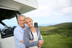 Senior couple travelling with camping car Stock Image