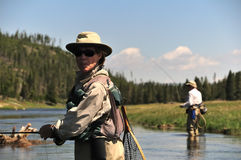Senior couple trout fishing royalty free stock photography