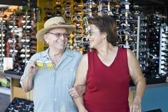 Senior Couple Trying On Funny Sunglasses Stock Image