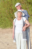 Senior couple. Two old people at beach in sailor suits Stock Image