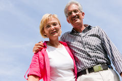 Senior couple under blue sky Stock Photos