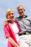 Senior couple under blue sky Stock Images