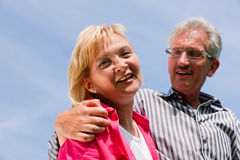Senior couple under blue sky Royalty Free Stock Photography