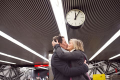 Senior couple at the underground platform, hugging and kissing Stock Photography