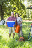 Senior Couple Unpacking Car For Camping Trip In Countryside Royalty Free Stock Photography