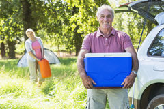 Senior Couple Unpacking Car For Camping Trip In Countryside Royalty Free Stock Images