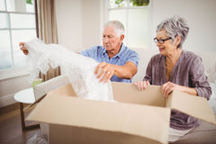 Senior couple unpacking a cardboard box Stock Photography