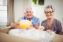 Senior couple unpacking a cardboard box Royalty Free Stock Photography