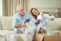 Senior couple unpacking carton boxes in living room Stock Photography
