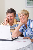 Senior couple use computer Stock Photos