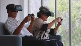 Senior couple uses VR which are fun virtual games. stock footage