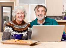 Senior couple using computer Stock Photos