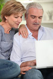 Senior couple using computer Stock Photography