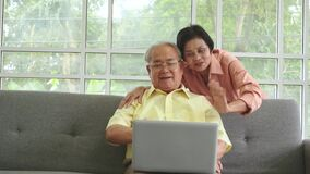 Senior couple is using computer Laptop to Video Call to connect with family and friend in quarantine period.