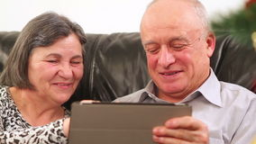 Senior couple using digital tablet at Christmas stock footage