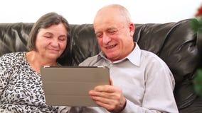 Senior couple using digital tablet at Christmas stock video footage
