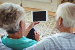 Senior couple using digital tablet Stock Images