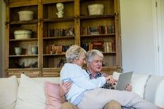 Senior couple using digital tablet Royalty Free Stock Photo