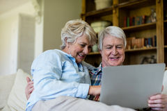 Senior couple using digital tablet Stock Image