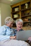 Senior couple using digital tablet Royalty Free Stock Photography