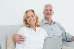 Senior couple using digital tablet at home Stock Image