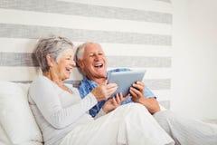 Senior couple using digital tablet Royalty Free Stock Image