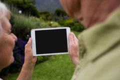 Senior couple using digital tablet Royalty Free Stock Photo
