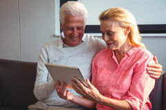 Senior couple using a digital tablet Royalty Free Stock Images