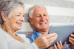 Senior couple using digital tablet Stock Photo
