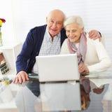 Senior couple using internet Royalty Free Stock Photo