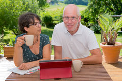 Senior couple using laptop computer at home. A senior couple using laptop computer at home, outdoor Royalty Free Stock Photo