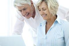 Senior couple using laptop Stock Image