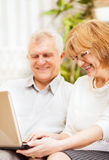 Senior couple using laptop Stock Photos