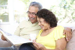 Senior Couple Using Laptop At Home Royalty Free Stock Photos