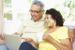 Senior Couple Using Laptop At Home Royalty Free Stock Images
