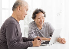Senior Couple Using Laptop in living room Royalty Free Stock Photo