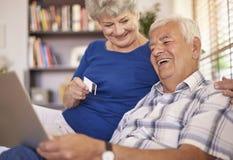 Senior couple using laptop Royalty Free Stock Photography