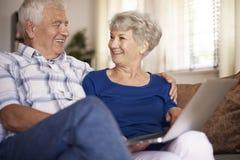 Senior couple using laptop Stock Photos