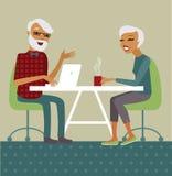 Senior couple using laptop. Trendy senior couple using laptop drinking tea Stock Images