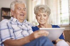 Senior couple using laptop Royalty Free Stock Image