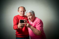 Senior couple using phone Stock Photos