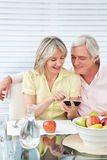 Senior couple using smartphone Stock Photos