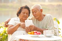 Senior couple using the tablet Stock Photography
